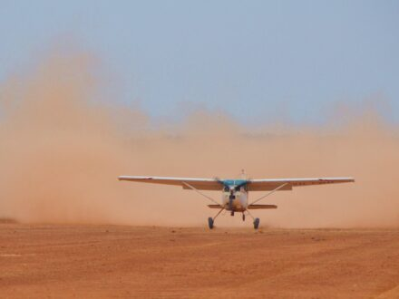 Light plane landing in the outback